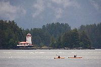 Kayakers paddle Sitka sound near the Rockwell lighthouse, a famous historical icon of the coastal town of Sitka, Alaska in Alaska's southeast panhandle.