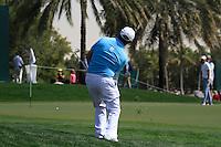 Damien McGrane (IRL) chips onto the 14th green during Saturday's  Round 3 of the 2012 Omega Dubai Desert Classic at Emirates Golf Club Majlis Course, Dubai, United Arab Emirates, 11th February 2012(Photo Eoin Clarke/www.golffile.ie)