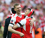 Per Mertesacker of Arsenal and Aaron Ramsey of Arsenal celebrate the win during the Emirates FA Cup Final match at Wembley Stadium, London. Picture date: May 27th, 2017.Picture credit should read: David Klein/Sportimage