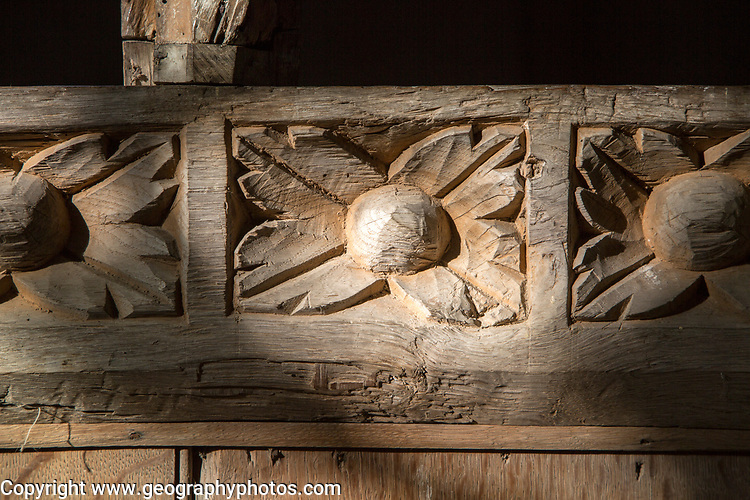Building interior medieval church architectural feature, Inglesham, Wiltshire, England, decorated wood carving detail close up