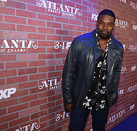 """LOS ANGELES - FEBRUARY 19: Amin Joseph arrives at the red carpet event for FX's """"Atlanta Robbin' Season"""" at the Ace Theatre on February 19, 2018 in Los Angeles, California.(Photo by Frank Micelotta/FX/PictureGroup)"""
