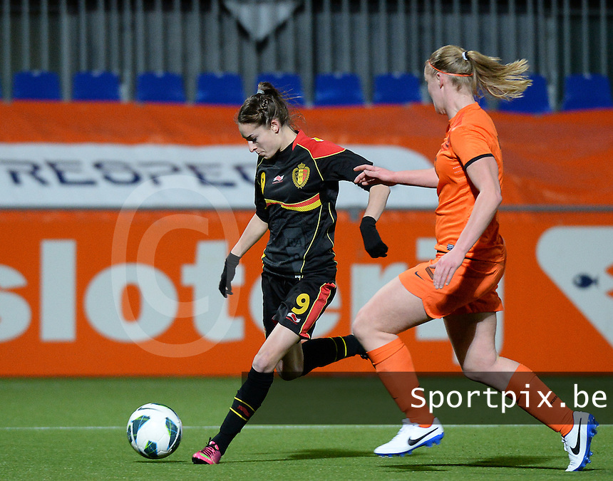 20140212 - ZWOLLE , THE NETHERLANDS : Belgian Tessa Wullaert (l) pictured with Dutch Stefanie Van Der Gragt (r) during the female soccer match between The Netherlands and Belgium , on the fifth matchday in group 5 of the UEFA qualifying round to the FIFA Women World Cup in Canada 2015 at Het Ijseldelta Stadion , Zwolle . Wednesday 12th February 2014 . PHOTO DAVID CATRY