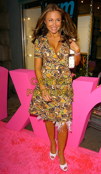 SAM RAMPLIN.AXM Magazine Summer Party at Getty Images Gallery, W1..August 4th, 2005.full length brown pattern print dress cleavage white shoes peep toe.www.capitalpictures.com.sales@capitalpictures.com.©Capital Pictures