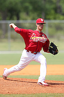 St. Louis Cardinals minor league pitcher Joe Kelly #4 delivers a pitch during a spring training game vs the Florida Marlins at the Roger Dean Sports Complex in Jupiter, Florida;  March 25, 2011.  Photo By Mike Janes/Four Seam Images