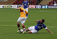 Nicky Law tackled by Seamus Coleman in the Motherwell v Everton friendly match at Fir Park, Motherwell on 21.7.12 for Steven Hammell's Testimonial.