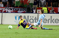 Thursday 08 August 2013<br /> Pictured: Petar Petrovic of Malmo (R) challenging Neil Taylor of Swansea (L)<br /> Re: Malmo FF v Swansea City FC, UEFA Europa League 3rd Qualifying Round, Second Leg, at the Swedbank Stadium, Malmo, Sweden.