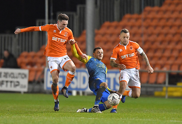 Blackpool's Jordan Thompson (left) and Jay Spearing (right) try to get the ball<br /> <br /> Photographer Dave Howarth/CameraSport<br /> <br /> The Emirates FA Cup Second Round Replay - Blackpool v Solihull Moors - Tuesday 18th December 2018 - Bloomfield Road - Blackpool<br />  <br /> World Copyright © 2018 CameraSport. All rights reserved. 43 Linden Ave. Countesthorpe. Leicester. England. LE8 5PG - Tel: +44 (0) 116 277 4147 - admin@camerasport.com - www.camerasport.com