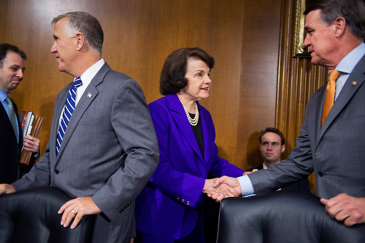 "UNITED STATES - JULY 21: From left, Sens. Thom Tillis, R-N.C., Dianne Feinstein, D-Calif., and David Perdue, R-Ga., attend a Senate Judiciary Committee hearing in Dirksen Building titled ""Oversight of the Administration's Misdirected Immigration Enforcement Policies: Examining the Impact on Public Safety and Honoring the Victims,"" July 21, 2015. The hearing featured testimony of families of victims who were killed by undocumented immigrants. (Photo By Tom Williams/CQ Roll Call)"