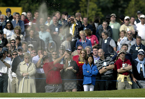 MARK CALCAVECCHIA (USA) plays out of a bunker beside the 5th green during his singles match against Harrington, The 34th Ryder Cup 2002, The Belfry, Sutton Coldfield, 020929. Photo:Glyn Kirk/Action Plus...golf golfer player.sand trap bunkers......