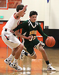 James Sandoval, with Manogue, drives past Douglas defender Nick Maestretti during a boys basketball game between Bishop Manogue and Douglas High in Minden, Nev., on Thursday, Dec. 22, 2011..Photo by Cathleen Allison