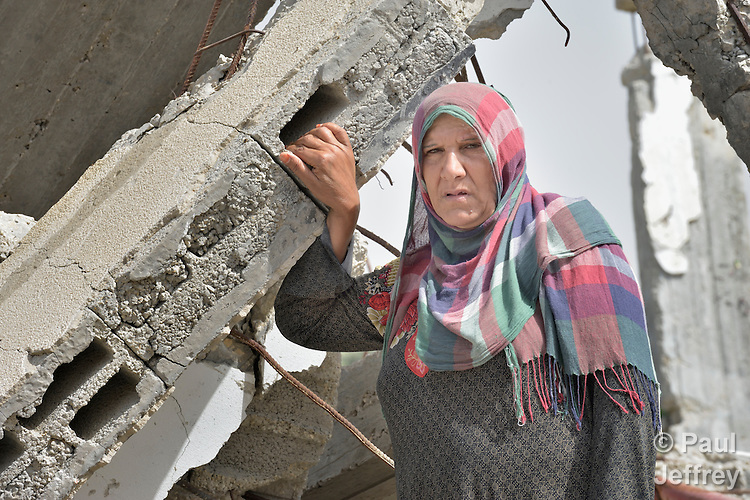 Moyasar El Za'anen stands in the rubble of her home in Beit Hanoun, Gaza, which was destroyed by an Israeli air strike in 2014. She has received assistance in reestablishing her family's farm from International Orthodox Christian Charities, a member of the ACT Alliance.