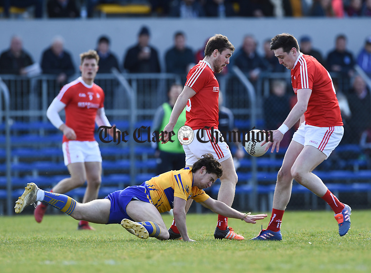Cian O Dea of Clare in action against Tommy Durnin of Louth during their national League game in Cusack Park. Photograph by John Kelly.