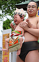 Babies held by sumo wrestlers cry for Nakizumo