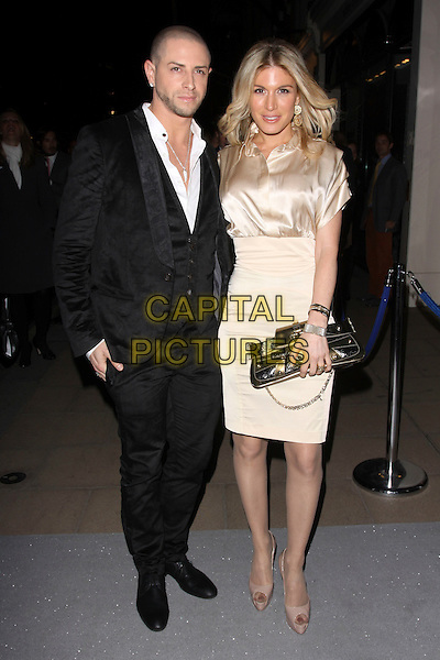 BRIAN FRIEDMAN & HOFIT GOLAN.The VIP private view ahead of the auction of Jerry Hall's Artwork Collection at Sotheby's, London, England. .October 13th, 2010.full length black suit waistcoat beige skirt silk satin nude clutch bag peep toe shoes .CAP/AH.©Adam Houghton/Capital Pictures.
