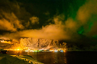 Clouds, fog and Northern Lights (Aurora Borealis) near Reine, Lofoten Islands, Arctic, Northern Norway.