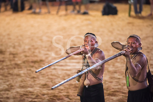 Two Matis warriors demonstrate the use of blowpipes, their traditional hunting weapon, during the International Indigenous Games, in the city of Palmas, Tocantins State, Brazil. Photo © Sue Cunningham, pictures@scphotographic.com 27th October 2015