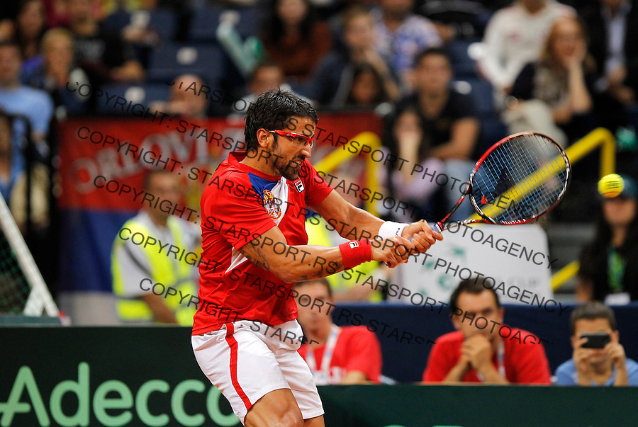 Tennis Tenis<br /> Davis Cup semifinal polufinale<br /> Serbia v Canada<br /> Janko Tipsarevic v Milos Raonic<br /> Janko Tipsarevic returned the ball<br /> Beograd, 13.09.2013.<br /> foto: Srdjan Stevanovic/Starsportphoto &copy;