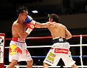 (L-R) Pornsawan Porpramook (THA), Akira Yaegashi (JPN), OCTOBER 24, 2011 - Boxing : Akira Yaegashi of Japan hits Pornsawan Porpramook of Thailand during the eighth round of the WBA minimumweight title bout at Korakuen Hall in Tokyo, Japan. (Photo by Mikio Nakai/AFLO)