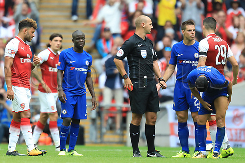August 6th 2017, Wembley Stadium, London, England; FA Community Shield Final, Arsenal versus Chelsea; Pedro of Chelsea is shown a red card for a studs up tackle on Mohamed Elneny