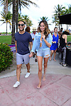 MIAMI BEACH, FL - FEBRUARY 20: John Legend and Christine Teigen participates in Sports Illustrated Swimsuit 2014 Beach Volleyball:Models & Celebrity Chefs on February 20, 2014 in Miami Beach, Florida. (Photo by Johnny Louis/jlnphotography.com)