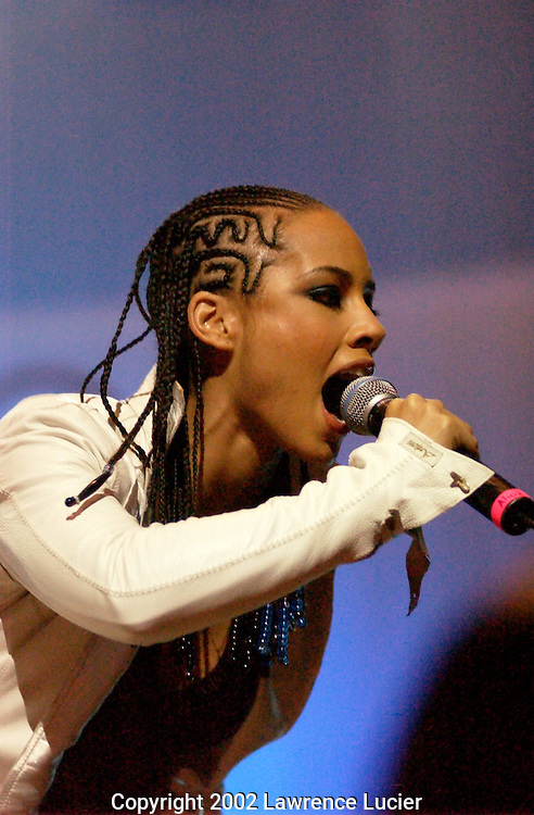 Recording artist Alicia Keys performs at Lifebeat's Urbanaid 2 April 9, 2002, in New York. Urbanaid2 is a benefit concert to increase awareness of HIV prevention and AIDS issues in the urban community..
