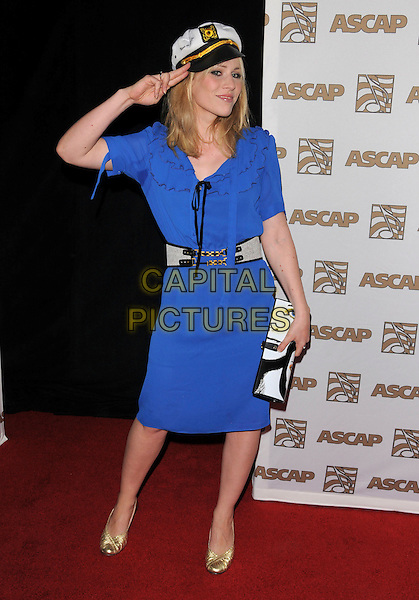 NATASHA BEDINGFIELD . at The 2008 ASCAP Pop Awards held at The Kodak Theatre in Hollywood, California, USA, April 09 2008                                                                   .full length blue dress sailor captain hat hand salute gesture frill collar bag gold shoes belt clutch bag nautical .CAP/DVS.©Debbie VanStory/Capital Picturestie