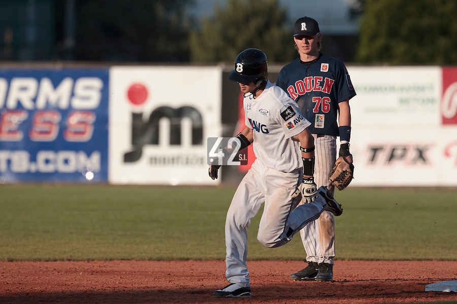 06 June 2010: Second base Martin Schneider of AVG Draci Brno runs the bases after his solo home run, passing by Luc Piquet during the 2010 Baseball European Cup match won 10-8 by the Rouen Huskies over AVG Draci Brno, at the AVG Arena, in Brno, Czech Republic.