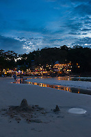 Beautiful sunset scene at Kata beach with small restaurants and surf line, Phuket, Thailand