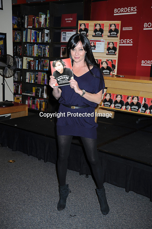 "Shannen Doherty posing for photographers at her book signing of ""Badass"" on November 2, 2010.at Borders at The Time Warner Center in New York City. .photo by Robin Platzer/ Twin Images"
