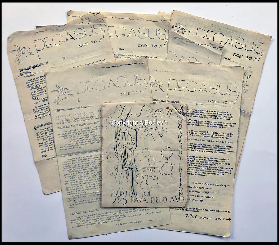 BNPS.co.uk (01202 558833)<br /> Pic :   Bosley's/BNPS<br /> <br /> Parachute regiment news letters.<br /> <br /> Top secret maps and documents belonging to a hero medic who served on D-Day have been unearthed 75 years later.<br /> <br /> Douglas Protheroe helped set up a field hospital at the cafe next to Pegasus Bridge in Normandy in the aftermath of the famous British assault there just after midnight on June 6, 1944.<br /> <br /> The team of medics removed wounded men from the bridge over the Caen Canal, coming under enemy fire while doing so.<br /> <br /> The maps showing Protheroe's drop zone are being sold by Bosley's Auctioneers.