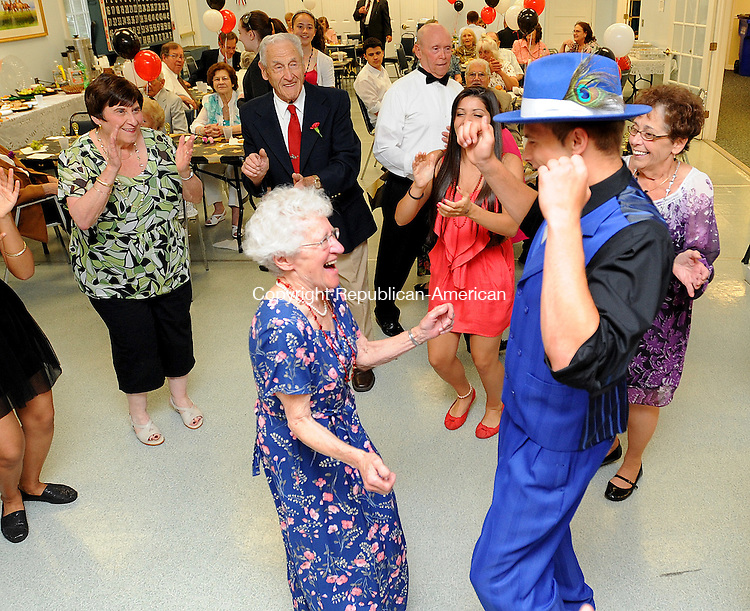 WATERTOWN  CT, 01 JUNE 2012-060112JS01-Tillie Brinkman of Watertown, left, dances with Waetrtown High School student Richard DiFederico III during the annual senior srom Friday at the Falls Avenue Senior Center in Watertown. The students are from the Watertown High School's Interact Club adn Student Council. .Jim Shannon Republican-American