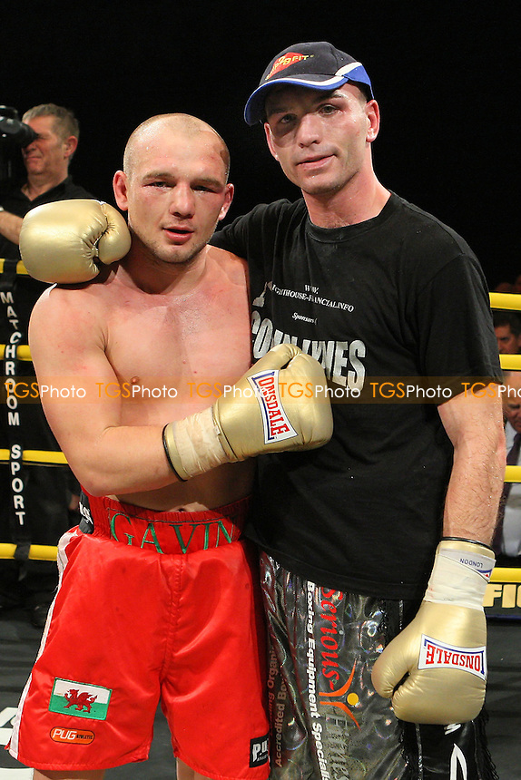 Gavin Rees (red shorts) defeats Colin Lynes in the Final of Prizefighter 'The Light-Welterweights' at Olympia National Hall, London, promoted by Barry Hearn / Matchroom Sport - 04/12/09 - MANDATORY CREDIT: Gavin Ellis/TGSPHOTO - Self billing applies where appropriate - Tel: 0845 094 6026