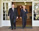 Australian Prime Minister Malcolm Turnbull (R) ajusts his tie before official photographs with Governor General Sir Peter Cosgrove (L) at Government House, Canberra on September 15, 2015. Photographer: Mark Graham/Bloomberg
