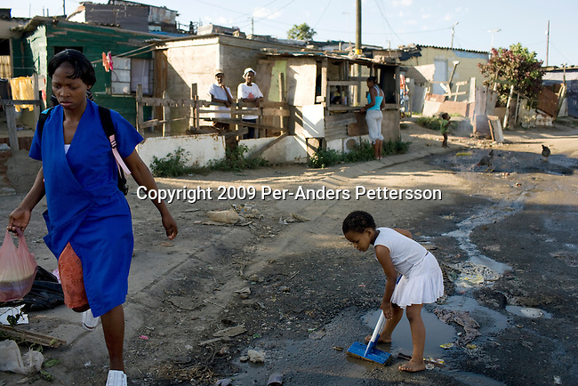 EAST LONDON, SOUTH AFRICA - MARCH 10: A child plays next to a garbage pile on March 10, 2009, in Duncan Village a poor township outside East London, South Africa. This area is one of the most popular ANC areas and many of its leaders grew up in the Eastern Cape province. Many people are disappointed in the ruling party and after 15 years of power, people?s lives have not changed much to the better. In Duncan Village, there?s lack of service delivery such as housing, electricity, and running water. Garbage is left on the streets and the municipality is only collecting it once a week, or they often skip a week. About 23 million South Africans are registered to vote on the April 22 national election. Jacob Zuma will most likely be the third elected head of a democratic South Africa. (Photo by: Per-Anders Pettersson/Getty Images)...