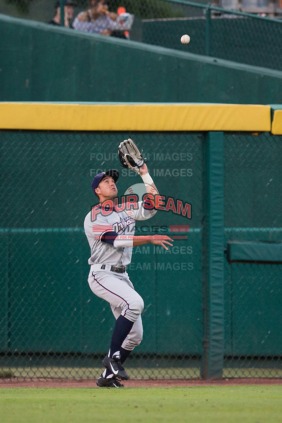 Lane Adams (8) of the Northwest Arkansas Naturals catches a ball in left field during a game against the Springfield Cardinals at Hammons Field on August 20, 2013 in Springfield, Missouri. (David Welker/Four Seam Images)