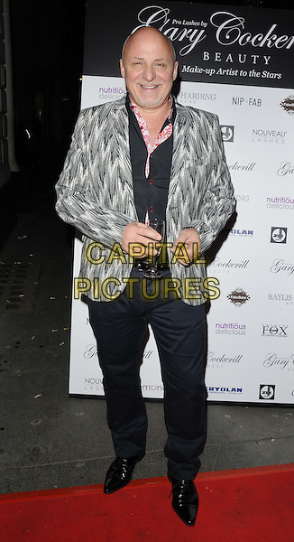 Aldo ZIlli.attended the Pro Lashes by Gary Cockerill Beauty launch party, Charles Fox Kryolan boutique, Tavistock St., London, England, UK, .29th November 2012..full length blue black trousers shirt white printed patterned jacket blazer glass.CAP/CAN.©Can Nguyen/Capital Pictures.