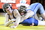 SIOUX FALLS, SD: DECEMBER 8: Ben Gillette from South Dakota State rides Blake Jans from Augustana in their 133 pound match Sunday afternoon at the Sanford Pentagon. (photo by Dave Eggen/Inertia)