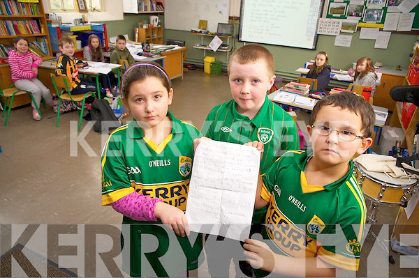 Jessica Dale, Richard Lehane and Harry Dale, Lauragh National School, Kenmare pictured with the letter which they  wrote to Taoiseach Enda Kenny where they told him how they feel about the Governments plans for their school...........................