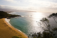 View of Waimea Bay Beach Park on the North Shore of Oahu, Hawaii, as seen from above, with Kaena Point in the background