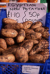 A752N0 Egyptian new potatoes on sale in Britain close up view with label and price