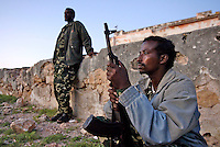 Armed 'security agents' in Eyl. The distinction between good and bad guys in Somalia is often blurred. Men with guns can be hired by anybody who has the money. The town of Eyl is a base for local pirates, and piracy has fuelled the local economy.