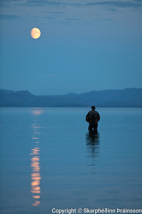 Fishing under a blue moon. Þingvallavatn, national park south west Iceland