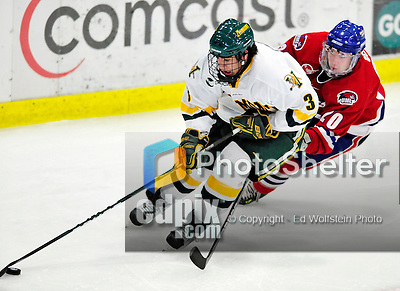 6 November 2009: University of Vermont Catamount forward Chris McCarthy, a Freshman from Collegeville, PA, is chased by University of Massachusetts Lowell River Hawk forward Michael Scheu, a Sophomore from Buffalo, NY, in the third period at Gutterson Fieldhouse in Burlington, Vermont. The Hockey East rivals battled to a 3-3 tie. Mandatory Credit: Ed Wolfstein Photo