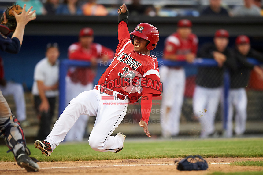 Batavia Muckdogs designated hitter Jhonny Santos (32) slides into home during a game against the Brooklyn Cyclones on July 5, 2016 at Dwyer Stadium in Batavia, New York.  Brooklyn defeated Batavia 5-1.  (Mike Janes/Four Seam Images)