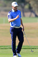 Marc Warren (SCO) sinks his putt on the 9th green during Thursday's Round 1 of the 2016 Portugal Masters held at the Oceanico Victoria Golf Course, Vilamoura, Algarve, Portugal. 19th October 2016.<br /> Picture: Eoin Clarke | Golffile<br /> <br /> <br /> All photos usage must carry mandatory copyright credit (&copy; Golffile | Eoin Clarke)