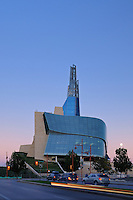 Canadian Museum for Human Rights (CMHR) with car traffic at dusk<br /> Winnipeg<br /> Manitoba<br /> Canada