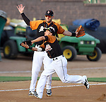 SIOUX FALLS, SD - MAY 18:  Corey Morales #4 from the Sioux Falls Pheasants runs in front of teammate Cesar Nicolas #18 to make a catch for an out against the Sioux City Explorers in the third inning of their game Friday night in Sioux Falls. (Photo by Dave Eggen/Inertia)
