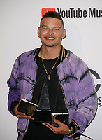 LOS ANGELES, CA - OCTOBER 09: Kane Brown, winner of the Favorite Male Artist - Country award poses in the press room during the 2018 American Music Awards at Microsoft Theater on October 9, 2018 in Los Angeles, California. <br /> CAP/MPI/IS<br /> &copy;IS/MPI/Capital Pictures