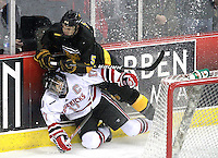 Colorado College's Aaron Harstad collides with Nebraska-Omaha's Terry Broadhurst. Nebraska-Omaha defeated Colorado College 7-5 Friday night at CenturyLink Center in Omaha. (Photo by Michelle Bishop) .