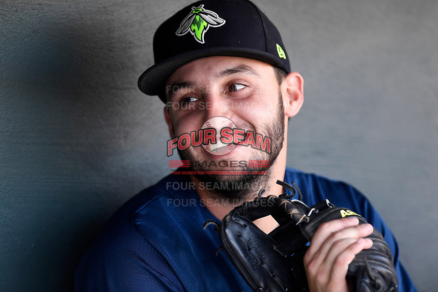 Second baseman Michael Paez (3) of the Columbia Fireflies talks with teammates in the dugout before a game against the Lexington Legends on Thursday, June 8, 2017, at Spirit Communications Park in Columbia, South Carolina. (Tom Priddy/Four Seam Images)